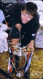 Gary the Dent Man removing a dent from the FA Premiership Trophy